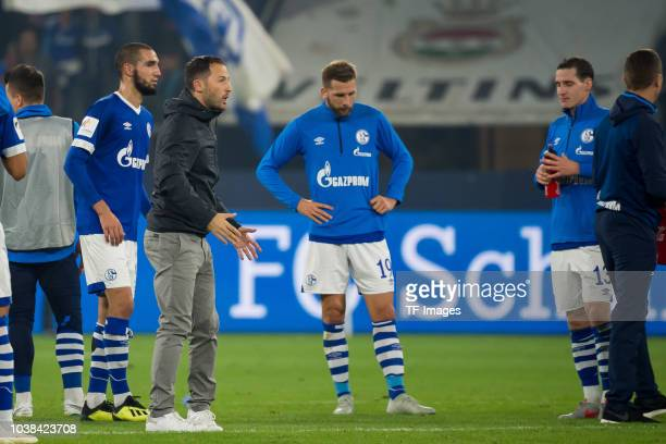 Head coach Domenico Tedesco of FC Schalke speaks to his players during the Bundesliga match between FC Schalke 04 and FC Bayern Muenchen at...