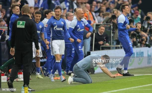 Head coach Domenico Tedesco of Schalke and Leon Goretzka of Schalke celebrate after winning the Bundesliga match between FC Schalke 04 and Borussia...