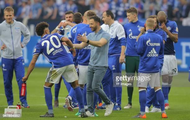 Head coach Domenico Tedesco of Schalke and Thilo Kehrer celebrate after winning the Bundesliga match between FC Schalke 04 and Borussia Dortmund at...