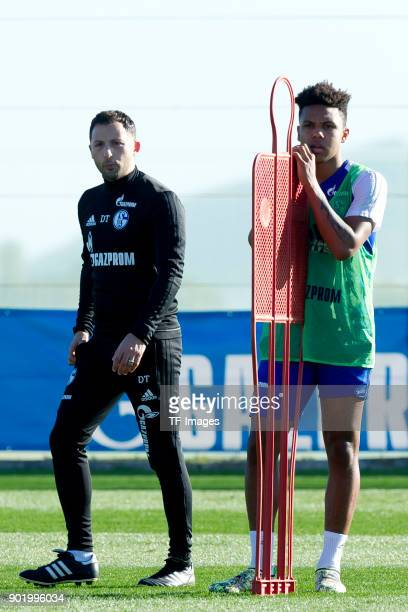 Head coach Domenico Tedesco of Schalke and Weston McKennie of Schalke look on during the FC Schalke 04 training camp at Hotel Melia Villaitana on...