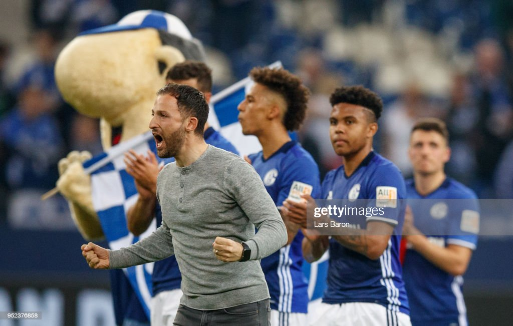 Head coach Domenico Tedesco of Schalke celebrates after the Bundesliga match between FC Schalke 04 and Borussia Moenchengladbach at Veltins-Arena on April 28, 2018 in Gelsenkirchen, Germany.