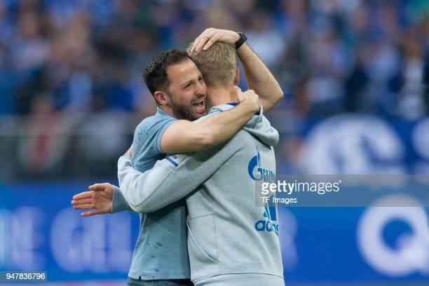 Head coach Domenico Tedesco of Schalke celebrates after winning the Bundesliga match between FC Schalke 04 and Borussia Dortmund at VeltinsArena on...