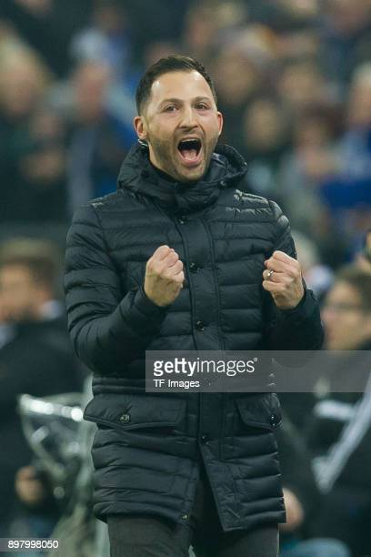 Head coach Domenico Tedesco of Schalke celebrates his team`s first goal during the DFB Cup match between FC Schalke 04 and 1 FC Koeln at VeltinsArena...