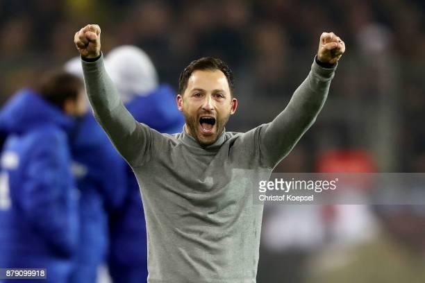 Head coach Domenico Tedesco of Schalke celebrates the 44 draw of the Bundesliga match between Borussia Dortmund and FC Schalke 04 at Signal Iduna...