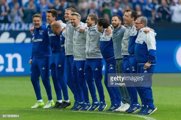 Head coach Domenico Tedesco of Schalke celebrates with his coach team after winning the Bundesliga match between FC Schalke 04 and Borussia Dortmund...