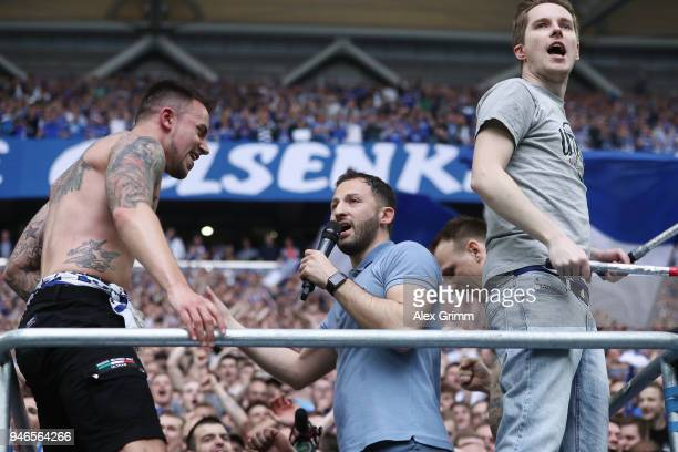 Head coach Domenico Tedesco of Schalke celebrates with the fans after the Bundesliga match between FC Schalke 04 and Borussia Dortmund at...