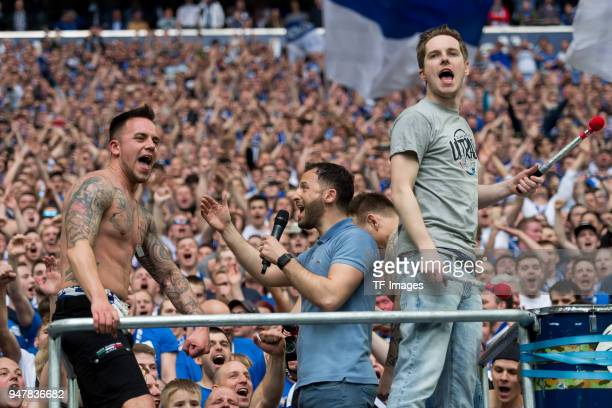 Head coach Domenico Tedesco of Schalke celebrates with their supporters after winning the Bundesliga match between FC Schalke 04 and Borussia...