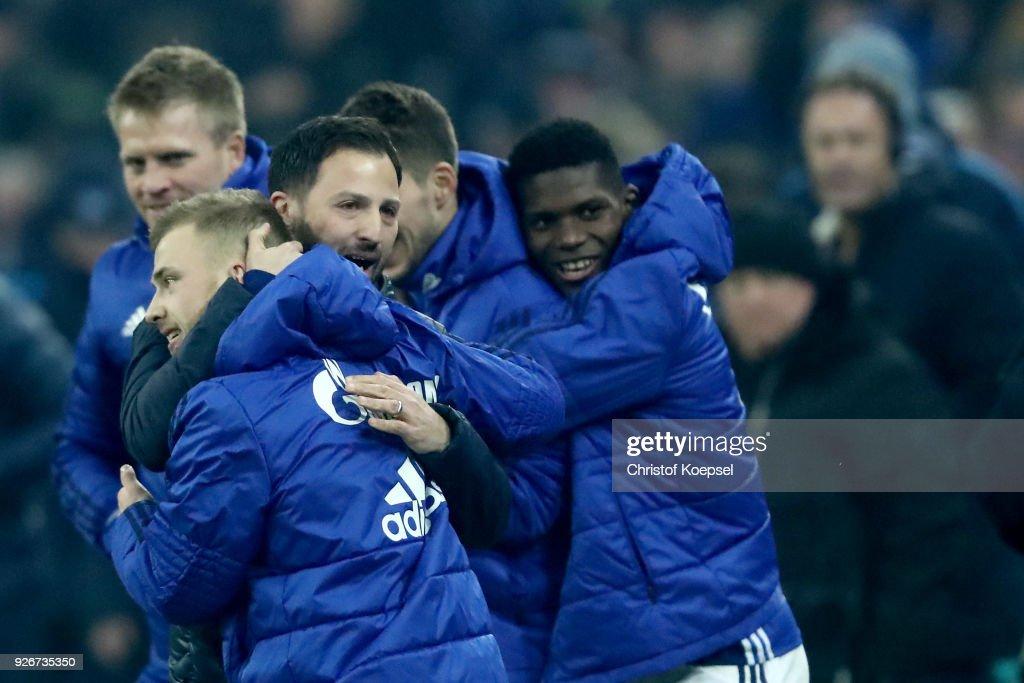 Head coach Domenico Tedesco of Schalke embraces Max Meyer after winning 1-0 the Bundesliga match between FC Schalke 04 and Hertha BSC at Veltins-Arena on March 3, 2018 in Gelsenkirchen, Germany.