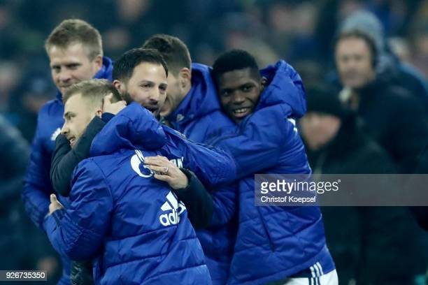 Head coach Domenico Tedesco of Schalke embraces Max Meyer after winning 10 the Bundesliga match between FC Schalke 04 and Hertha BSC at VeltinsArena...