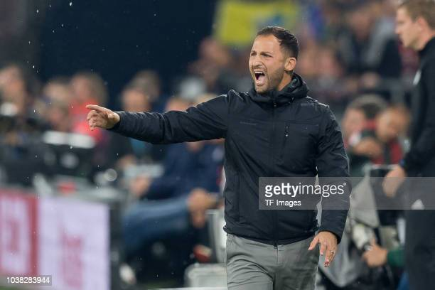Head coach Domenico Tedesco of Schalke gestures during the Bundesliga match between FC Schalke 04 and FC Bayern Muenchen at VeltinsArena on September...