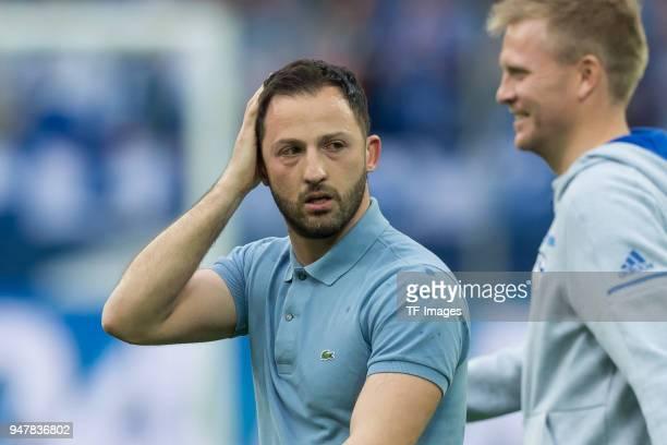 Head coach Domenico Tedesco of Schalke gestures during the Bundesliga match between FC Schalke 04 and Borussia Dortmund at VeltinsArena on April 15...