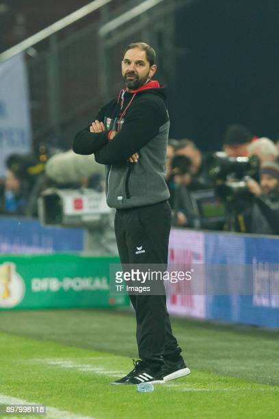 Head coach Domenico Tedesco of Schalke gestures during the DFB Cup match between FC Schalke 04 and 1 FC Koeln at VeltinsArena on December 19 2017 in...