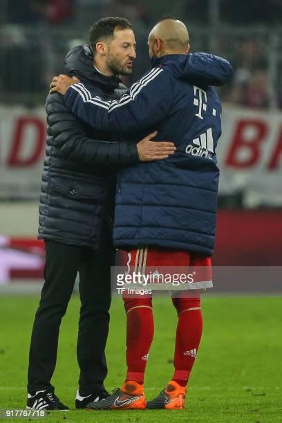 Head coach Domenico Tedesco of Schalke hugs Arturo Vidal of Bayern Muenchen during the Bundesliga match between FC Bayern Muenchen and FC Schalke 04...