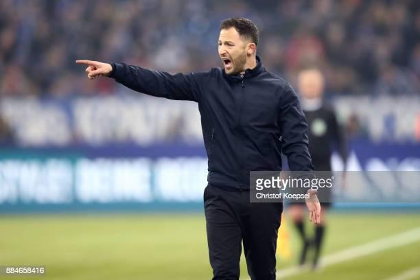 Head coach Domenico Tedesco of Schalke issues instructions during the Bundesliga match between FC Schalke 04 and 1 FC Koeln at VeltinsArena on...