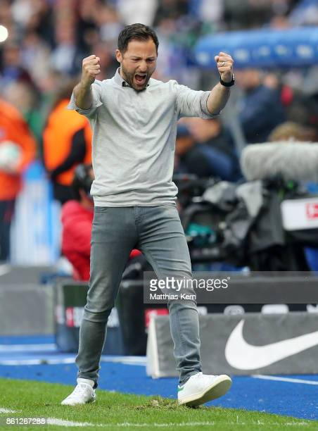 Head coach Domenico Tedesco of Schalke jubilates after winning the Bundesliga match between Hertha BSC and FC Schalke 04 at Olympiastadion on October...