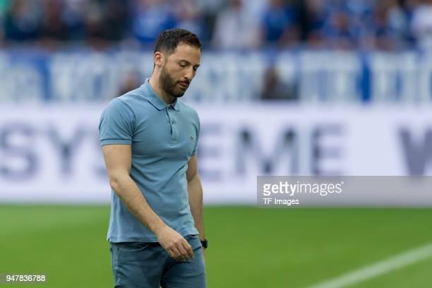 Head coach Domenico Tedesco of Schalke looks on during the Bundesliga match between FC Schalke 04 and Borussia Dortmund at VeltinsArena on April 15...