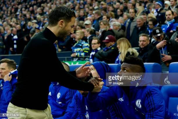 Head coach Domenico Tedesco of Schalke shakes hands with Breel Embolo of Schalke prior the Bundesliga match between FC Schalke 04 and Hamburger SV at...