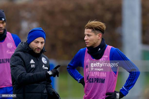 Head coach Domenico Tedesco of Schalke speaks with Amine Harit of Schalke during a training session at the FC Schalke 04 Training center on December...