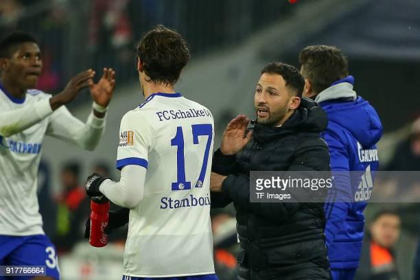 Head coach Domenico Tedesco of Schalke speaks with Benjamin Stambouli of Schalke during the Bundesliga match between FC Bayern Muenchen and FC...