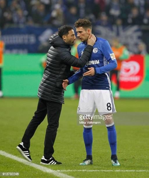 Head coach Domenico Tedesco talks with Leon Goretzka of Schalkeduring the Bundesliga match between FC Schalke 04 and SV Werder Bremen at VeltinsArena...