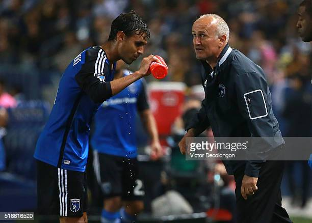 Head Coach Dominic Kinnear of the San Jose Earthquakes gives Chris Wondolowski instructions during a break in action against the Los Angeles Galaxy...