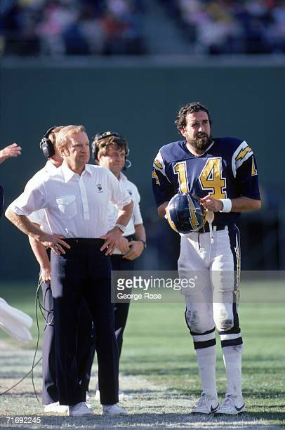 Head coach Don Coryell and quarterback Dan Fouts of the San Diego Chargers discuss strategy on the sidelines during a game against Buffalo Bills at...