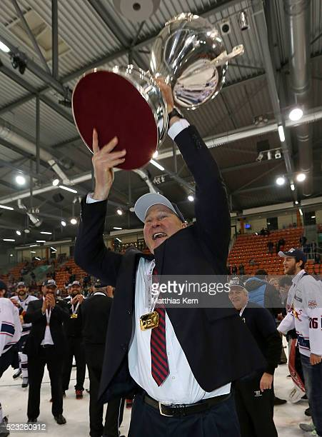 Head coach Don Jackson of Muenchen poses with the trophy after winning the DEL playoffs final game four between Grizzlys Wolfsburg and Red Bull...