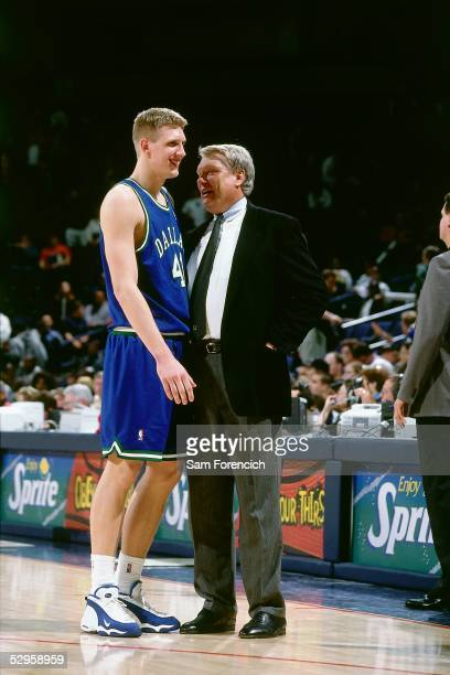 Head Coach Don Nelson of the Dallas Mavericks shares a light moment with Mavericks rookie star forward Dirk Nowitzki during an NBA game circa 1999...