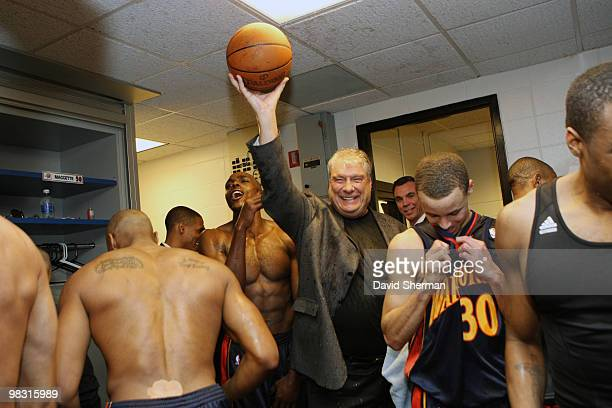 Head coach Don Nelson of the Golden State Warriors holds up the game ball in celebration of becoming the alltime NBA winningest coach with 1333 wins...