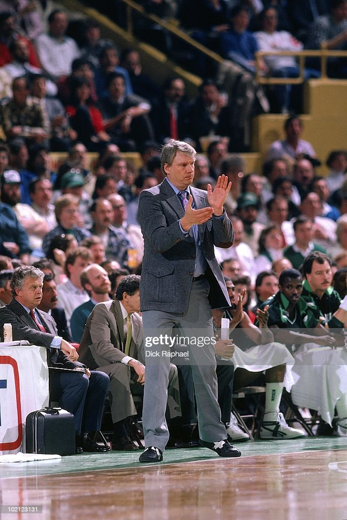 Head coach Don Nelson of the Milwaukee Bucks applauds against the Boston Celtics during a game played in 1987 at the Boston Garden in Boston, Massachusetts.