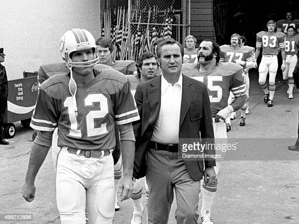 Head coach Don Shula and quarterback Bob Griese of the Miami Dolphins lead the team onto the field prior to Super Bowl VIII on January 13 1974...
