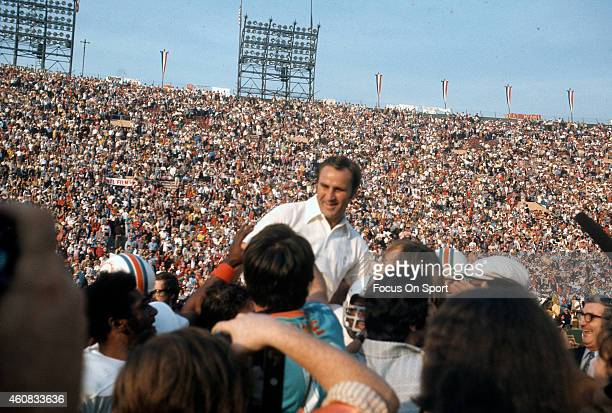 Head Coach Don Shula of the Miami Dolphins gets carried off the field after defeating the Washington Redskins in Super Bowl VII at the Los Angeles...