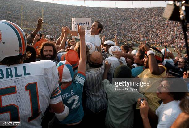 Head Coach Don Shula of the Miami Dolphins gets carried off the field by his players after they defeated the Washington Redskins in Super Bowl VII at...