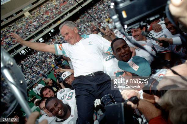 Head coach Don Shula of the Miami Dolphins is carried off the field by Dolphins players after recording his 325th career victory a 1914 win over the...