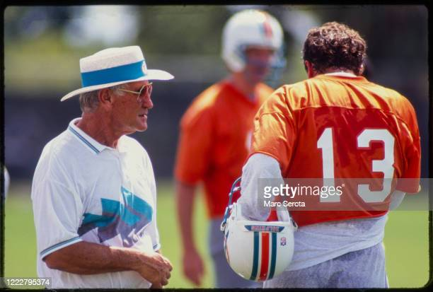 Head Coach Don Shula of the Miami Dolphins on the sidelines with Quarterback Dan Marino during practice Circa 1990 in Davie Florida