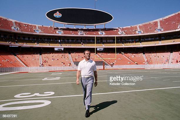 Head coach Don Shula of the Miami Dolphins walks onto the field prior the first game of the regular season against the Kansas City Chiefs on...