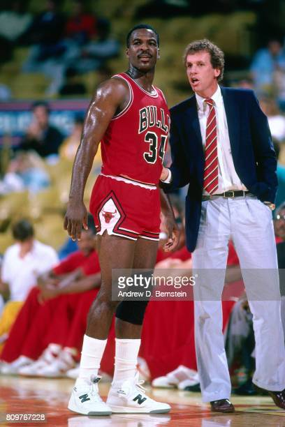 Head Coach Doug Collins and Charles Oakley of the Chicago Bulls talk during a game played against the Los Angeles Lakers circa 1986 at the Great...
