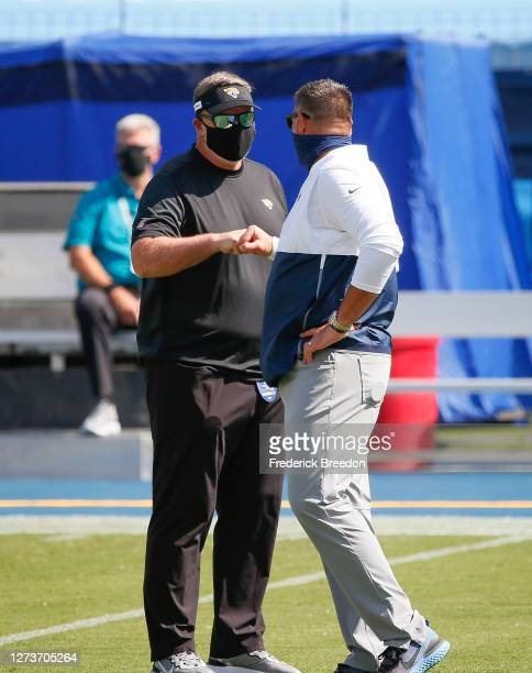 Head coach Doug Marrone of the Jacksonville Jaguars fist bumps head coach Mike Vrabel of the Tennessee Titans prior to a game at Nissan Stadium on...