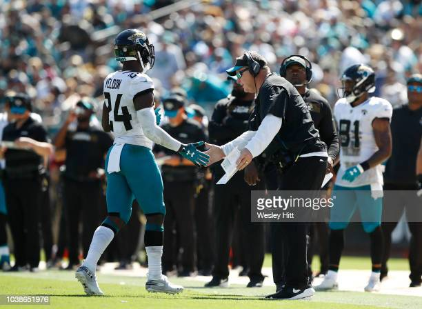 Head coach Doug Marrone of the Jacksonville Jaguars greets TJ Yeldon near the sidelines during their game against the Tennessee Titans at TIAA Bank...