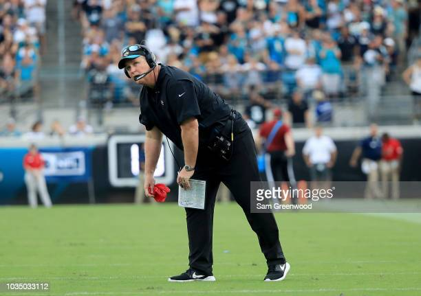 Head coach Doug Marrone of the Jacksonville Jaguars picks up a red flag during the game against the New England Patriots at TIAA Bank Field on...
