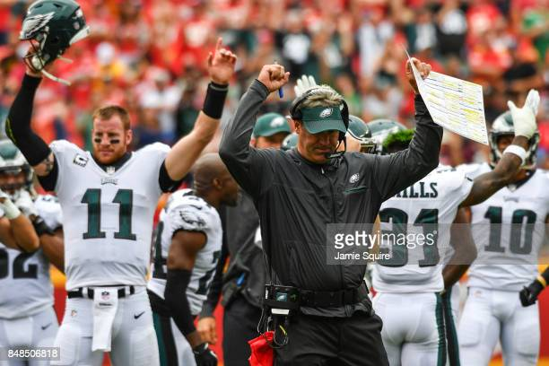 Head coach Doug Pederson and Carson Wentz of the Philadelphia Eagles puts their arms up after a successful coaches challenge leads to a touchdown in...