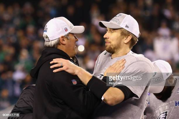 Head coach Doug Pederson and Nick Foles of the Philadelphia Eagles celebrate their teams win over the Minnesota Vikings in the NFC Championship game...