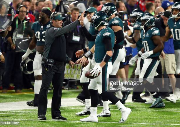 Head coach Doug Pederson celebrates with Nick Foles of the Philadelphia Eagles after Foles caught a 1 yard touchdown pass against the New England...