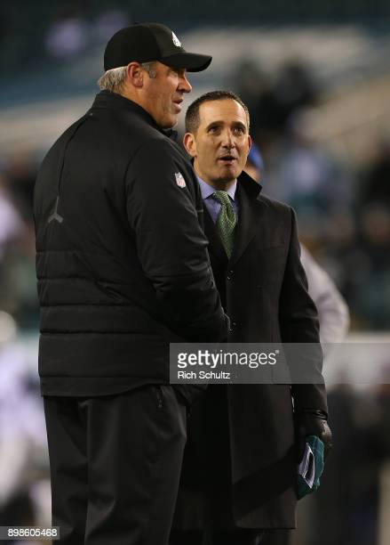 Head coach Doug Pederson left of the Philadelphia Eagles talks with General Manager Howie Roseman prior to a game against the Oakland Raiders at...