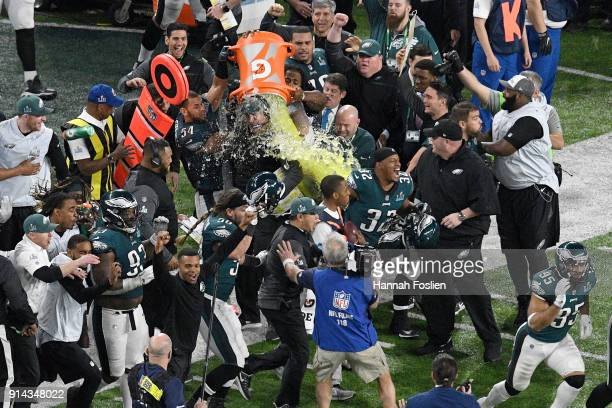 Head coach Doug Pederson of the Philadelphia Eagles gets a ice bath after defeating the New England Patriots 4133 in Super Bowl LII at US Bank...