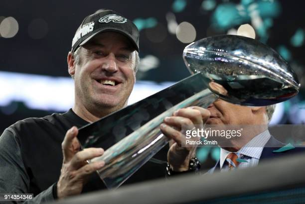 Head coach Doug Pederson of the Philadelphia Eagles raises the Vince Lombardi Trophy after defeating the New England Patriots 4133 in Super Bowl LII...