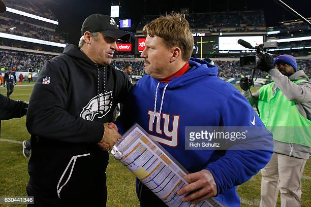 Head coach Doug Pederson of the Philadelphia Eagles shakes hands with head coach Ben McAdoo of the New York Giants after their game at Lincoln...