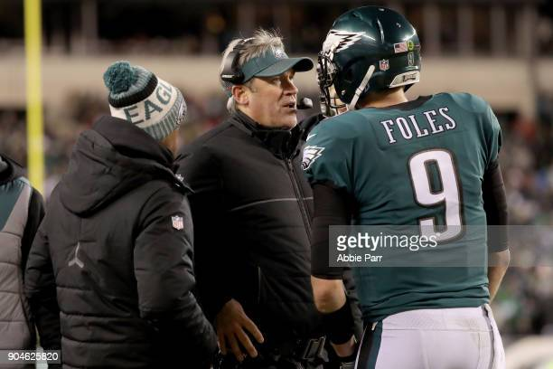 Head coach Doug Pederson of the Philadelphia Eagles talks Nick Foles on the sidelines against the Atlanta Falcons during the fourth quarter in the...