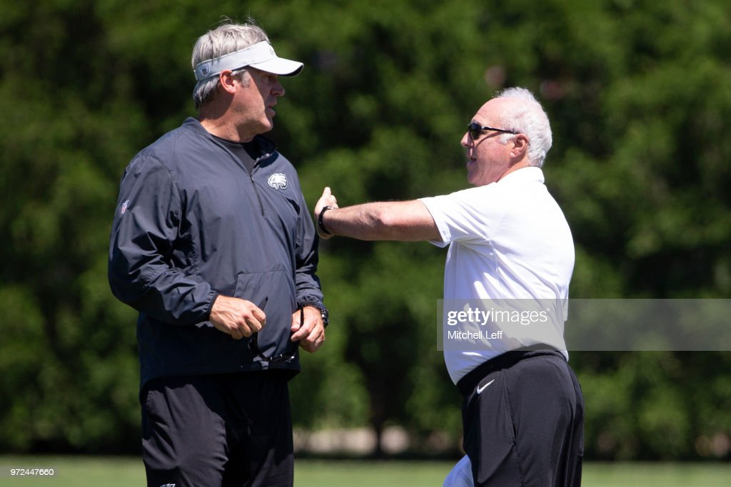 Head coach Doug Pederson of the Philadelphia Eagles talks to owner Jeffrey Lurie after Eagles minicamp at the NovaCare Complex on June 12, 2018 in Philadelphia, Pennsylvania.