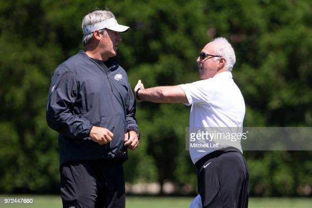 Head coach Doug Pederson of the Philadelphia Eagles talks to owner Jeffrey Lurie after Eagles minicamp at the NovaCare Complex on June 12, 2018 in...
